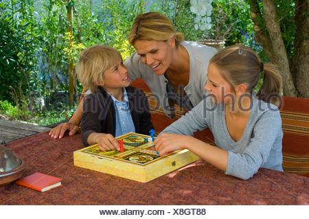 Family playing ludo - Stock Photo
