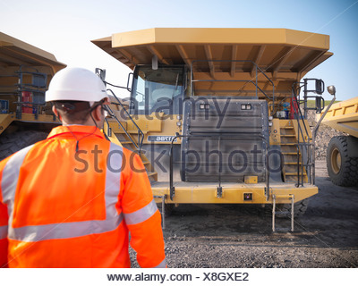 Worker with equipment in coal mine - Stock Photo