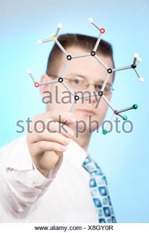 close up portrait of young chemist - Stock Photo