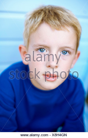 Thoughtful boy. He is six years old. - Stock Photo