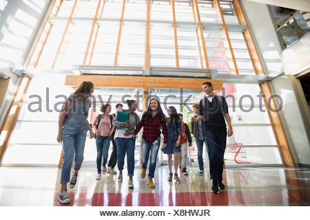 High school students entering school doors - Stock Photo