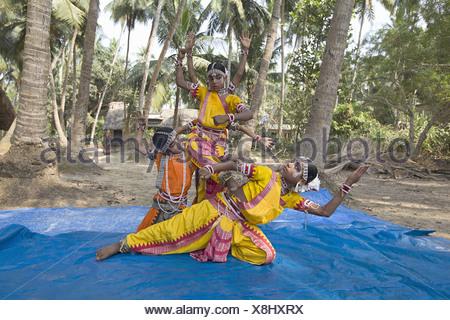 Tribal girls performing classical dance in gurukul - Stock Photo