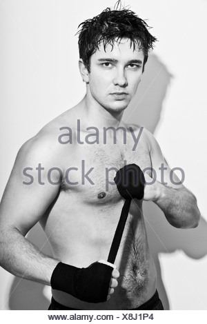 Boxer wrapping his hands - Stock Photo