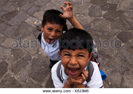 Two boys, School of Santiago Atitlan, Lago de Atitlan, Guatemala, Central America - Stock Photo