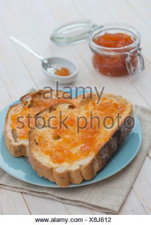 Pink Grapefruit Marmalade on toast - Stock Photo
