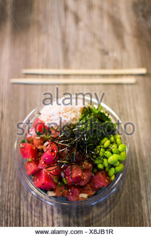 Poke, traditional Hawaiian dish with raw fish and beans, Seattle, Washington State, USA - Stock Photo