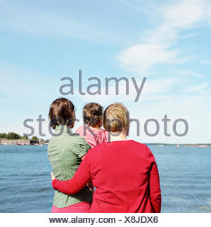 Finland, Helsinki, Uusimaa, Rear view of mother, daughter (2-3) and grandmother - Stock Photo