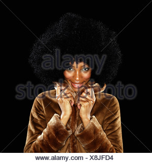Young woman in fur coat with afro - Stock Photo