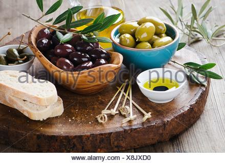 Fresh olives and olive oil platter - Stock Photo