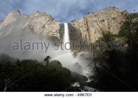 Bridalveil Fall with rainbow in Yosemite National Park, California, USA - Stock Photo