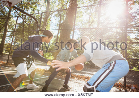 Young men playing basketball - Stock Photo