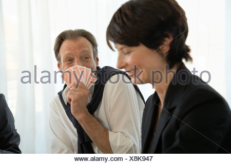 Man and woman playing cards - Stock Photo