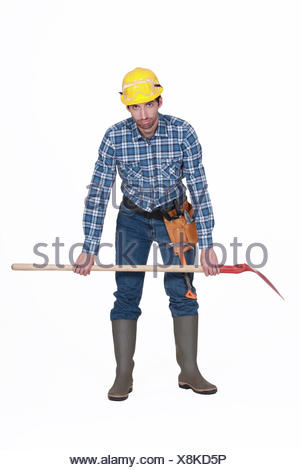 Tired builder with spade - Stock Photo