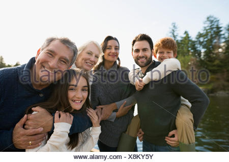Portrait multi-generation family at lakeside - Stock Photo