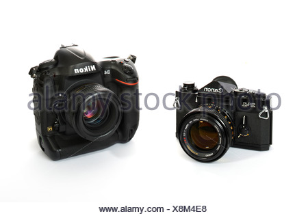 40 years of professional cameras, professional SLR Canon F-1, 1972, next to digital SLR Nikon D4, 2012 - Stock Photo