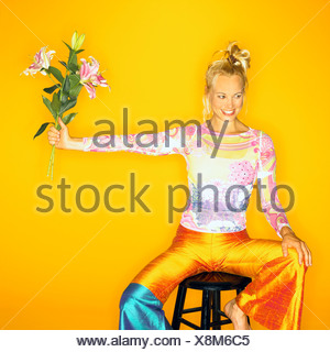 Woman holding flowers - Stock Photo