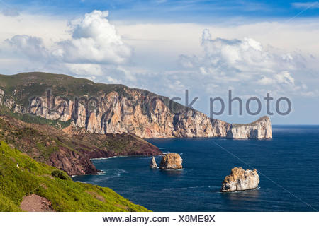 View of the coast near Masua, in the distance the Pan di Zucchero reef. Masua, Sulcis-iglesiente, Iglesias, Sardinia, Italy. - Stock Photo