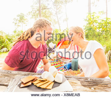 USA, Florida, Tequesta, Couple sitting at table with snacks - Stock Photo