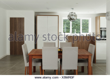 Table and chairs in dining area - Stock Photo