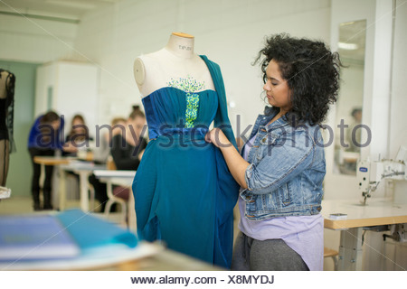Fashion design students in class - Stock Photo