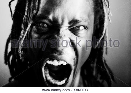 Close-Up Portrait Of Angry Man - Stock Photo
