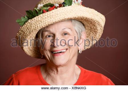lady female hat eccentric old elderly grey gray elder woman laugh laughs - Stock Photo