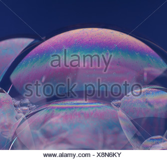 SOAP BUBBLE SHOWING MOLECULAR MOVEMENT OF THE LIPIDS ON THE SURFACE FILM; PATTERNS CAUSED BY INTERFERENCE OF LIGHT WAVES - Stock Photo