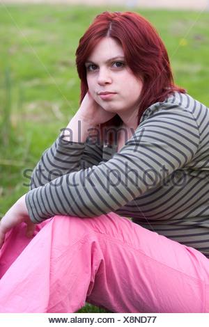 Obese teenager girl unhappy look at camera - Stock Photo
