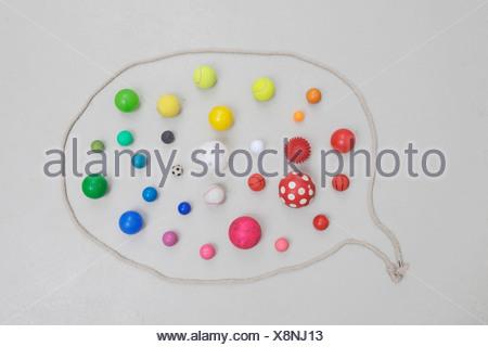 Variety of balls in speech bubble - Stock Photo