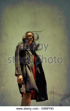 Windy Woman in Black Coat - Stock Photo