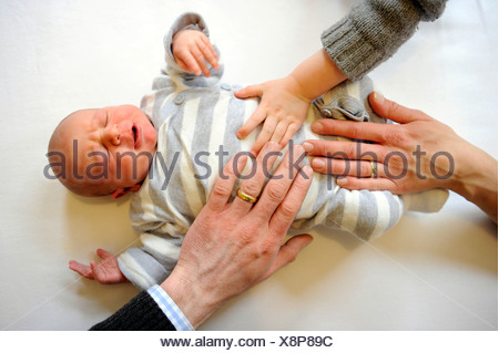 Family with newborn baby, one week old, boy - Stock Photo