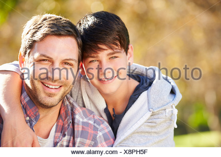 Portrait Of Father And Son In Countryside - Stock Photo