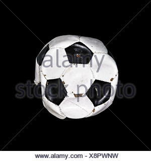 Worn out football - Stock Photo