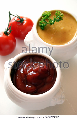 Curry and tomatoe dips - Stock Photo