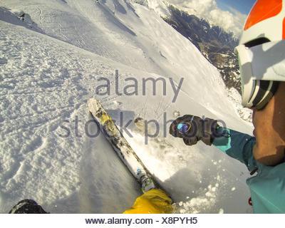 Man downhill powder skiing, Gastein, Salzburg, Austria - Stock Photo