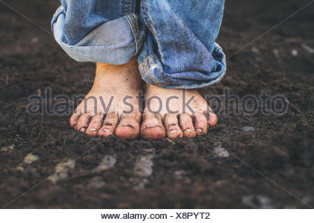 Close-up of a boy's dirty feet - Stock Photo