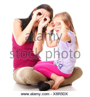 litle baby laughing toddler girl playing mom doing fun - Stock Photo