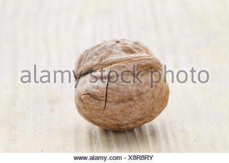 Walnut on wooden background - Stock Photo