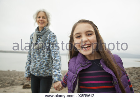 A day out at Ashokan lake. A mature woman holding hand with a young girl. - Stock Photo