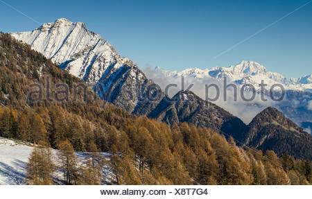 Different ridges in front of me: first, the hardest east ridge of Zerbion, and over the clouds, in the background, Mont Blanc. (Val d'Ayas, Vallée d'Aoste, Italy) - Stock Photo