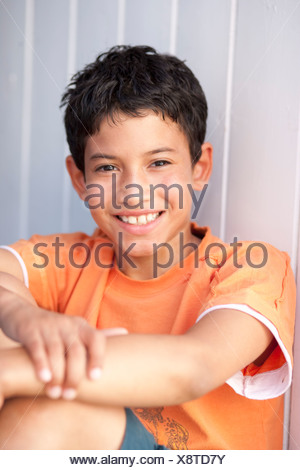 Close up of boys smiling face - Stock Photo