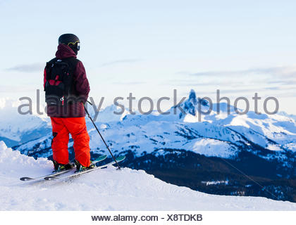 Skier looking into the distance - Stock Photo