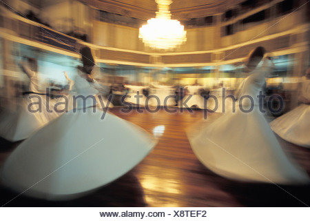 The Whirling Dervishes Perform Sema Galata Mevlevihanesi Istanbul - Stock Photo