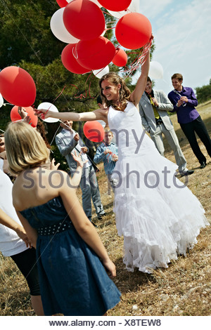 Wedding Guests With Balloons Outdoors, Croatia, Europe - Stock Photo