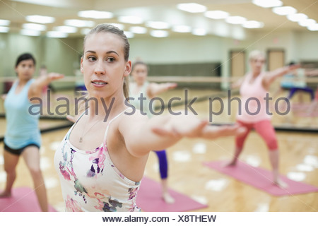 health club women doing stretching fitness aerobics and