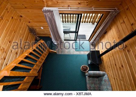 Nice warm interior of mountain lodge apartment Fox Glacier Lodge, Fox Glacier, West Coast, South Island, New Zealand - Stock Photo
