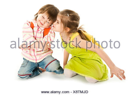 One child kissing another - Stock Photo