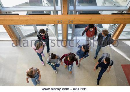 Overhead view high school students entering doors - Stock Photo