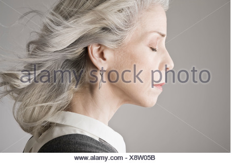Side view of mature woman with eyes closed - Stock Photo