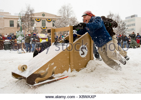 Alaska, Anchorage. Fur Rondezvous winter carnival. Outhouse races. - Stock Photo